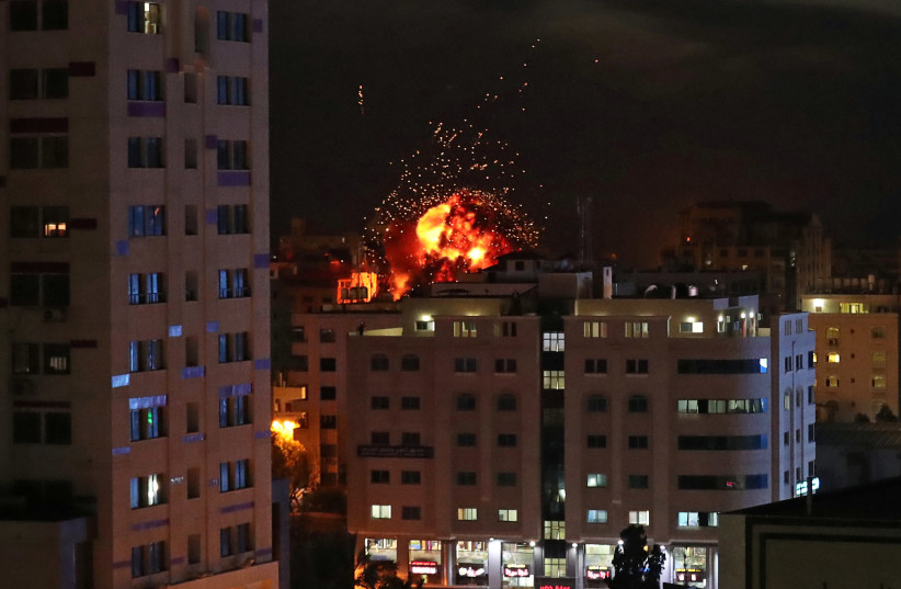 A ball of fire is seen during an Israeli air strike in Gaza City May 4, 2019. (photo credit: SUHAIB SALEM / REUTERS)