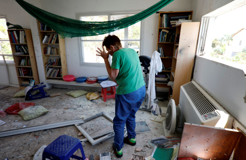 Yael Nisinbaum reacts after house near the Gaza border was struck by a rocket fired into Israel on May 4, 2019 (photo credit: AMIR COHEN/REUTERS)