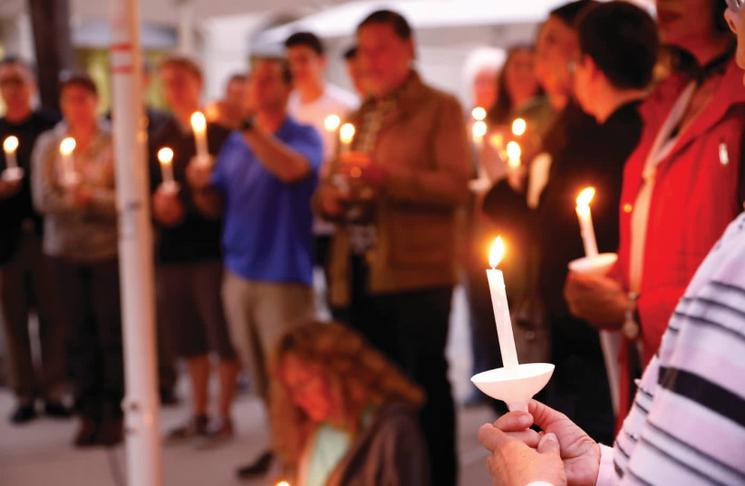 A CANDLELIGHT VIGIL is held at Rancho Bernardo Community Presbyterian Church for victims of the attack at the Chabad synagogue in Poway, California, April 27, 2019 (photo credit: JOHN GASTALDO/REUTERS)