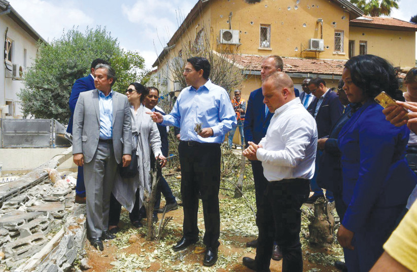 ISRAEL'S AMBASSADOR to the UN Danny Danon leads a delegation of UN ambassadors on a tour  of Ashkelon to view damage from last weekend's rockets.  (photo credit: PERMANENT MISSION OF ISRAEL TO THE UN)