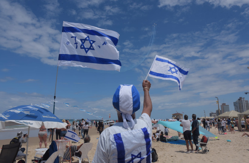 Israelis celebrate Independence Day on the beach, 2019. (photo credit: AVSHALOM SASSONI)