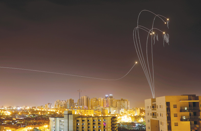 THE IRON DOME air defense system fires interceptor missiles over Ashkelon on Sunday. (photo credit: AMIR COHEN/REUTERS)
