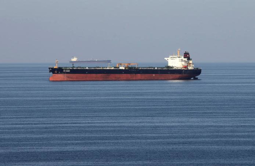 Oil tankers pass through the Strait of Hormuz (photo credit: REUTERS/HAMAD I MOHAMMED)