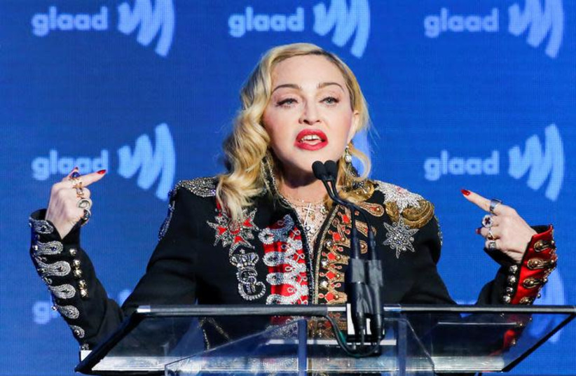 Singer Madonna speaks to guests after receiving the Advocate for Change award during the 30th annual GLAAD awards ceremony in New York City (photo credit: REUTERS/EDUARDO MUNOZ)