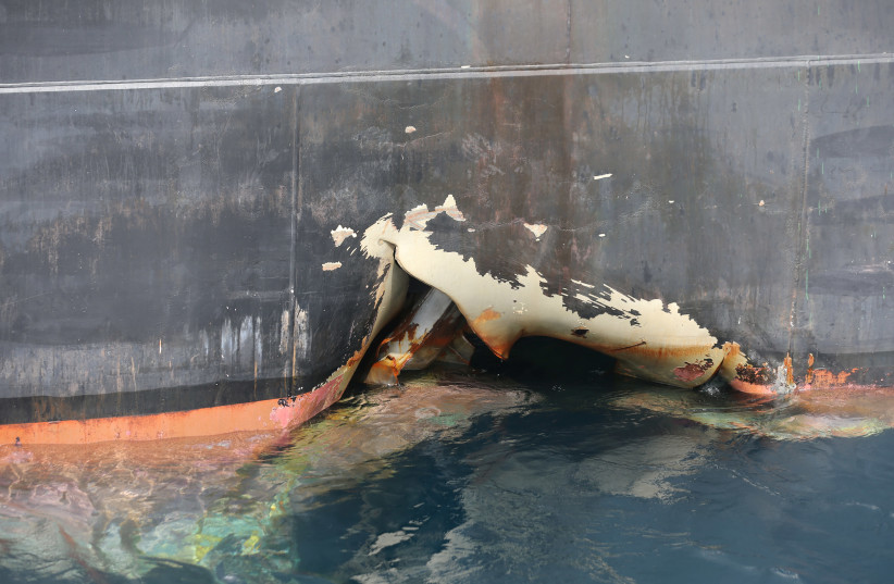 A damaged ANDREA VICTORY ship is seen off the Port of Fujairah, United Arab Emirates, May 13, 2019.  (photo credit: SATISH KUMAR/REUTERS)