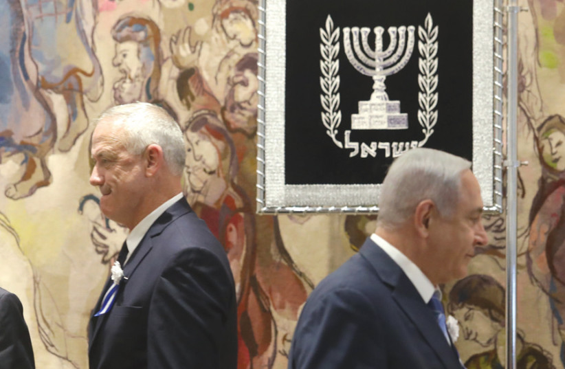 Tension was evident between Blue and White leader Benny Gantz and Prime Minister Benjamin Netanyahu at the opening of the Knesset's new session on April 30 (photo credit: MARC ISRAEL SELLEM)