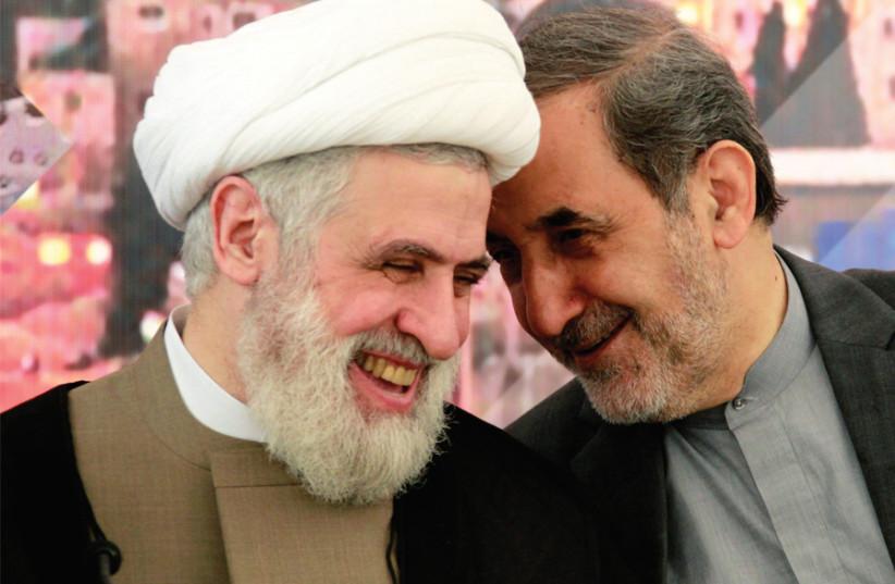 Ali Akbar Velayati, Iran's Supreme Leader Ayatollah Ali Khamenei's top advisor on international affairs, talks with Lebanon's Hezbollah deputy leader, Sheikh Naim Qassem, during a conference on 'The World Federation of Resistance scholars' (photo credit: AZIZ TAHER/REUTERS)