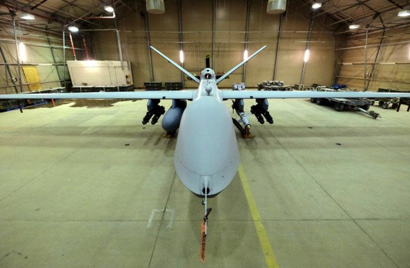 A U.S. Air Force MQ-9 Reaper drone sits armed with Hellfire missiles and a 500-pound bomb in a hanger at Kandahar Airfield, Afghanistan (photo credit: REUTERS)