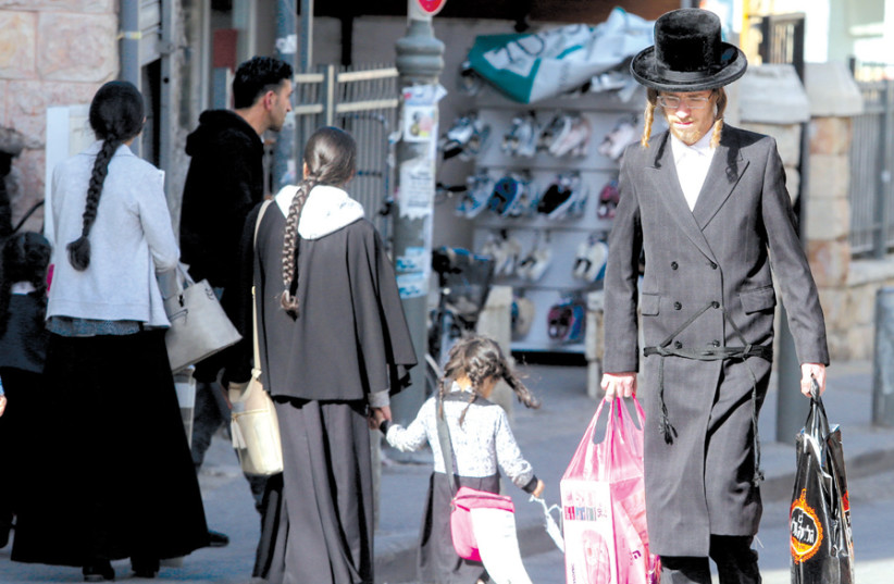 A HAREDI man walks in Jerusalem's Geula neighborhood. (photo credit: MARC ISRAEL SELLEM)