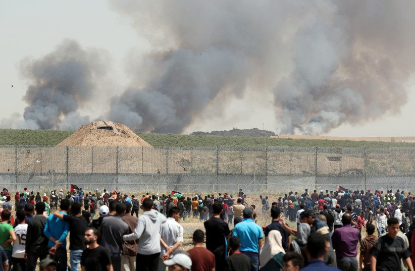Fires near the Gaza border seen in background of Nakba Day protests 2019 (photo credit: REUTERS/MOHAMMED SALEM)