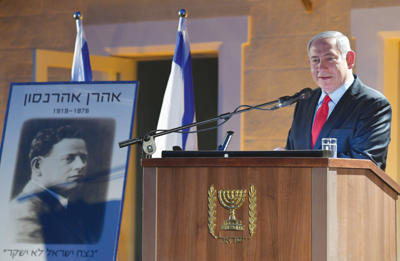 Prime Minister Benjamin Netanyahu speaks in Atlit at the 100th anniversary commemoration of the passing of Zionist hero Aaron Aaronsohn (photo credit: KOBI GIDEON/GPO)