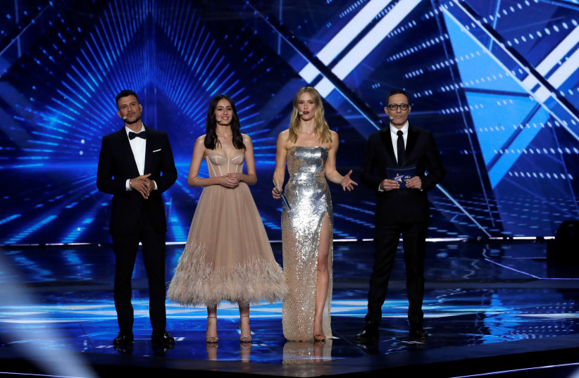 Hosts of the 2019 Eurovision Song Contest, Bar Refaeli, Erez Tal, Assi Azar and Lucy Ayoub stand on stage during the Grand Final of the contest in Tel Aviv, Israel May 18, 2019 (photo credit: RONEN ZVULUN/REUTERS)