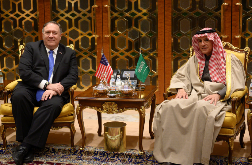U.S. Secretary of State Mike Pompeo meets with Saudi's Minister of State for Foreign Affairs Adel al-Jubeir upon his arrival in Riyadh, Saudi Arabia January 13, 2019 (photo credit: ANDREW CABALLERO-REYNOLDS/REUTERS)