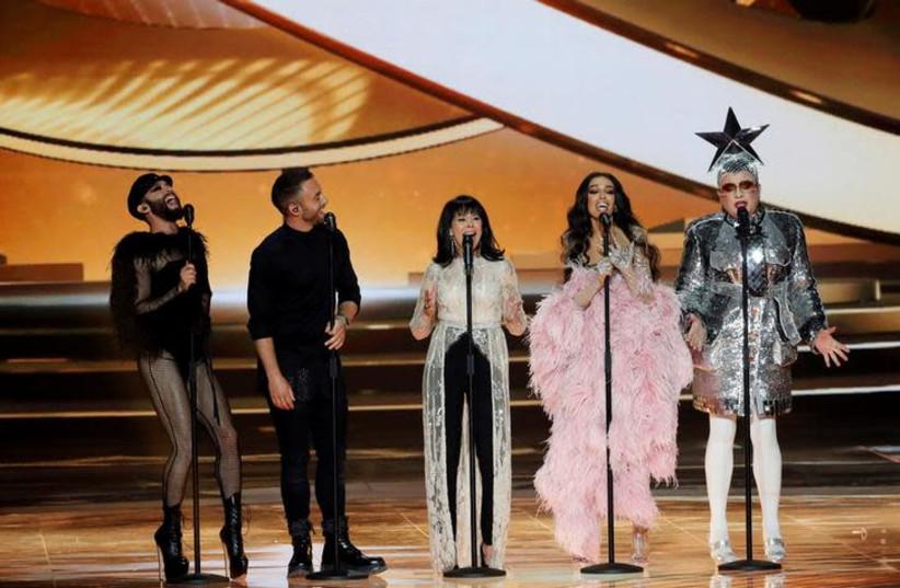 Conchita Wurst, Måns Zelmerlöw, Gali Atari, Eleni Foureira and Verka Serduchka perform during the Grand Final of the 2019 Eurovision Song Contest in Tel Aviv, Israel May 18, 2019.  (photo credit: REUTERS/Ronen Zvulun)