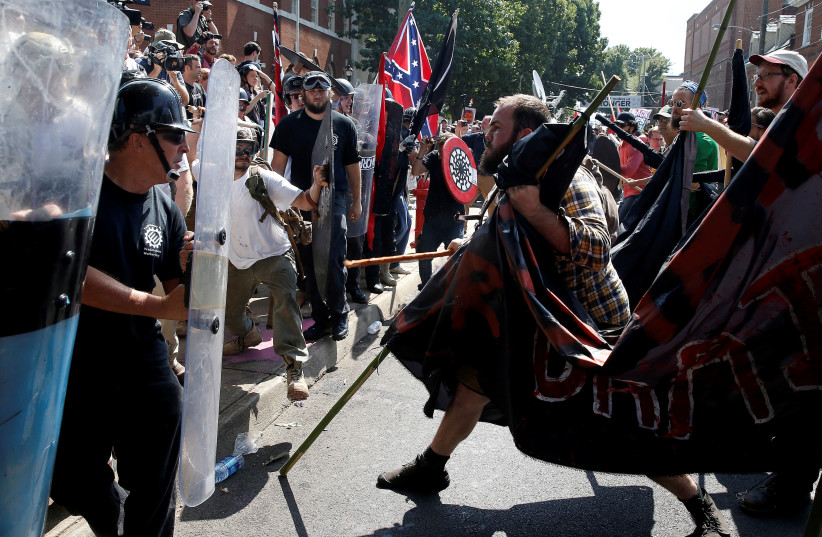 White supremacists clash with counter protesters at a rally in Charlottesville, Virginia, U.S., August 12, 2017 (photo credit: REUTERS/JOSHUA ROBERTS)