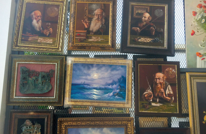 PICTURES DEPICTING Jews as lovers of money are featured at a Moscow art exhibition. (photo credit: SUSIE WEISS)