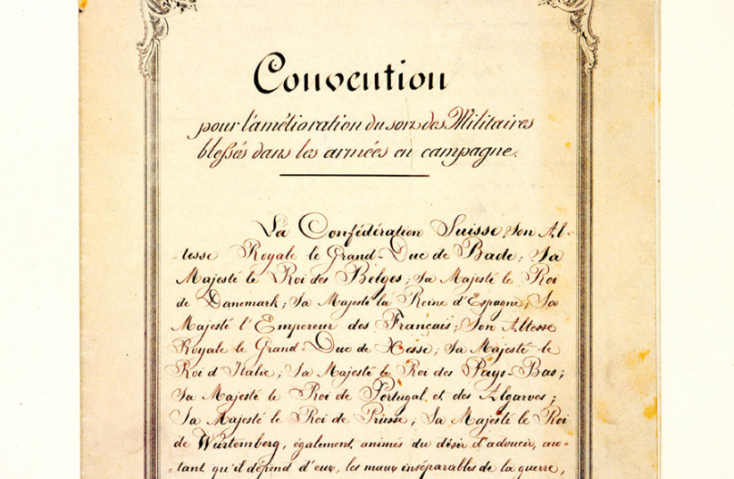 THe 1864 Geneva Convention, the first codified international treaty that covered sick and wounded soldiers on the battlefield (first page). (photo credit: ICRC/FLICKR)