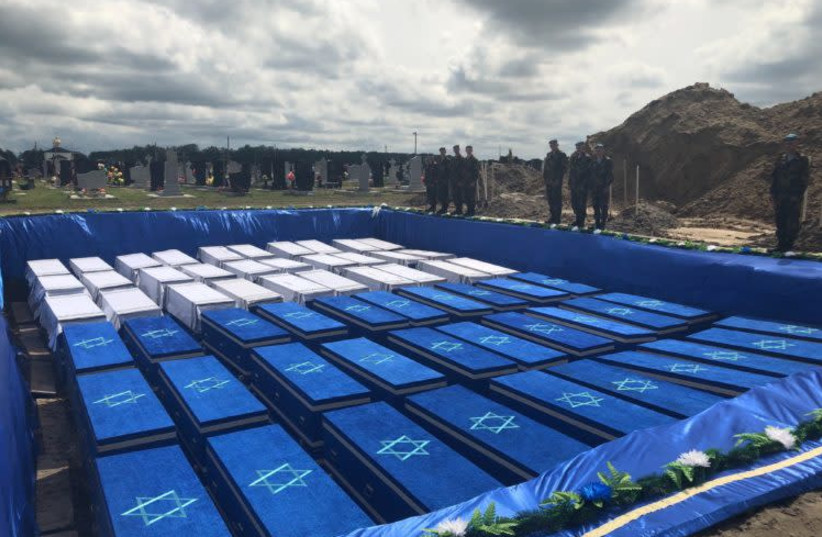 Coffins, containing the bones of over 1000 Jews murdered in Holocaust await burial in Belarus. (photo credit: USA EMBASSY MINSK)