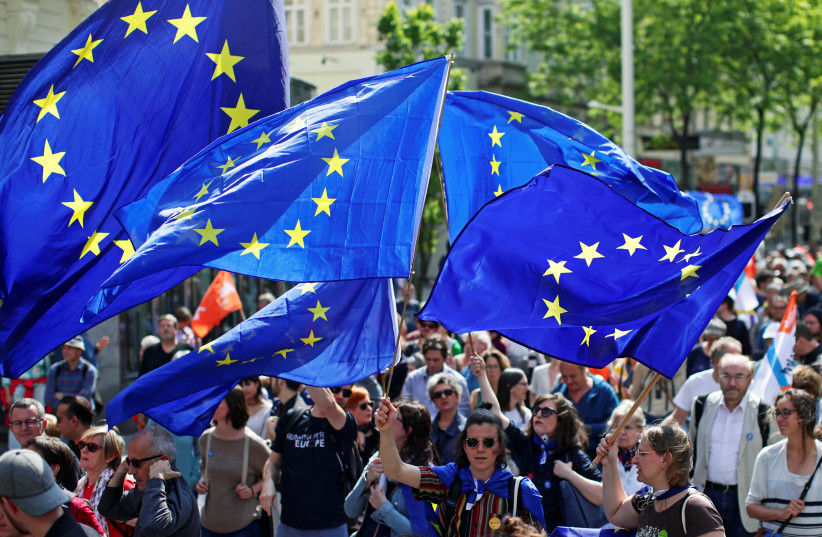 "European Union flags flutter as people take part in the demonstration ""One Europe for all"", a rally against nationalism across the European Union, in Vienna, Austria, May 19, 2019. (photo credit: LISI NIESNER)"