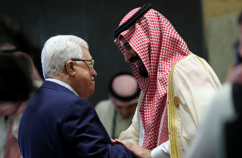 Saudi Arabia's Crown Prince Mohammed bin Salman greets Palestinian President Mahmoud Abbas before the start of the 29th Arab Summit in Dhahran, Saudi Arabia April 15, 2018 (photo credit: HAMAD I MOHAMMED/REUTERS)