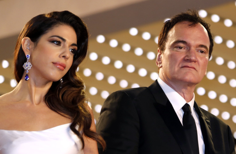 """72nd Cannes Film Festival - After the screening of the film """"Once Upon a Time in Hollywood"""" in competition - Red Carpet - Cannes, France, May 21, 2019. Director Quentin Tarantino poses with his wife Daniella Pick (photo credit: REGIS DUVIGNAU/REUTERS)"""