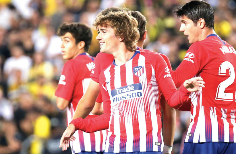 ANTOINE GRIEZMANN (front) and his Atletico Madrid teammates seemed just as excited to be in the Holy Land this week as the Israeli public was to host them. (photo credit: DANNY MARON)