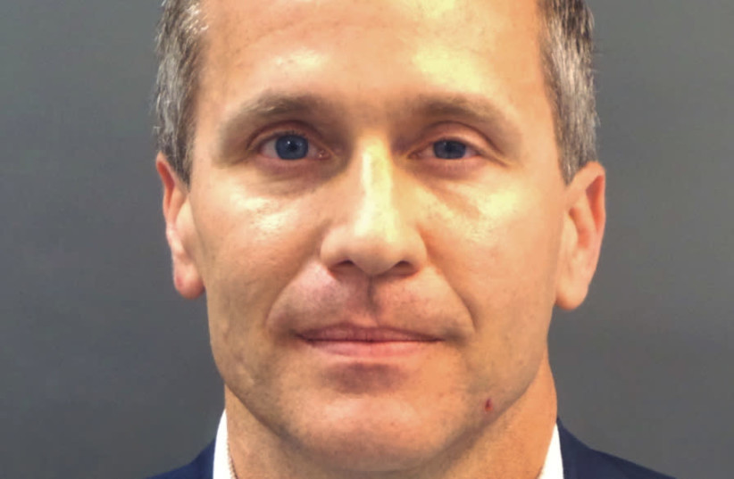 Missouri Governor Eric Greitens appears in a police booking photo in St. Louis (photo credit: HANDOUT/REUTERS)