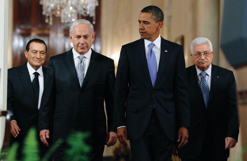 THEN-US president Barack Obama appears with Egypt's president Hosni Mubarak, Prime Minister Benjamin Netanyahu and Palestinian President Mahmoud Abbas in the East Room of the White House in Washington in 2010.  Peace process officials from the Clinton, Bush and Obama administrations wasted no time i (photo credit: JASON REED/REUTERS)