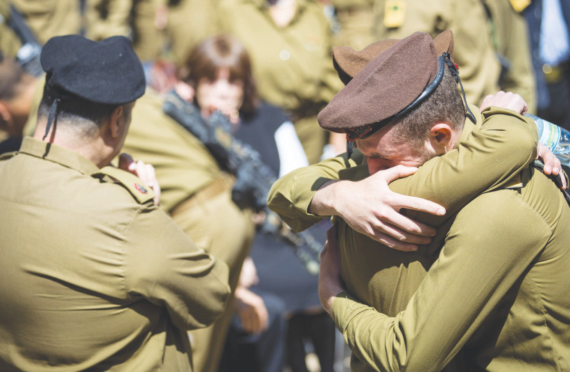 FRIENDS AND FAMILY mourn at the funeral of American lone soldier Alex Sasaki at the Mount Herzl Military Cemetery in Jerusalem, in March.  (photo credit: YONATAN SINDEL/FLASH 90)