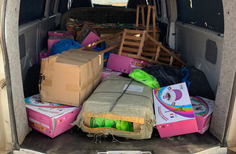 A vehicle filled with items that were planned to be sold by the Palestinians illegally (photo credit: POLICE SPOKESPERSON'S UNIT)
