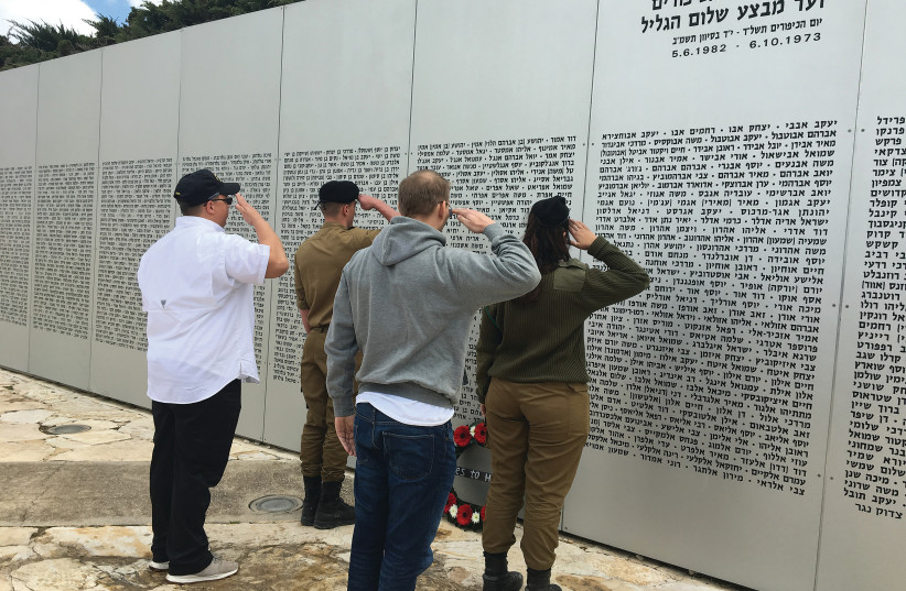 Heroes to Heroes participants with their Israeli counterparts lay a wreath at the Latrun Armored Corps Memorial. (photo credit: Courtesy)