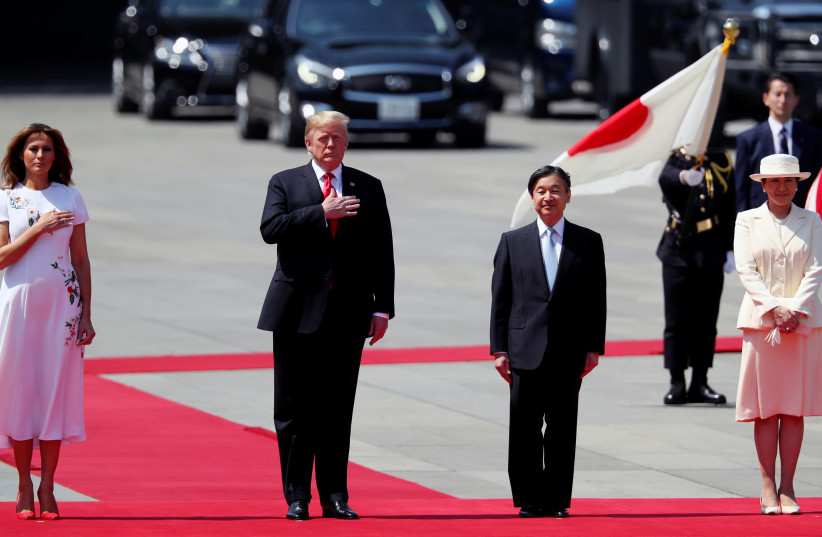 U.S. President Donald Trump and first lady Melania Trump stand at attention next to Japan's Emperor Naruhito and Empress Masako at the Imperial Palace in Tokyo, Japan May 27, 2019. (photo credit: REUTERS/JONATHAN ERNST)