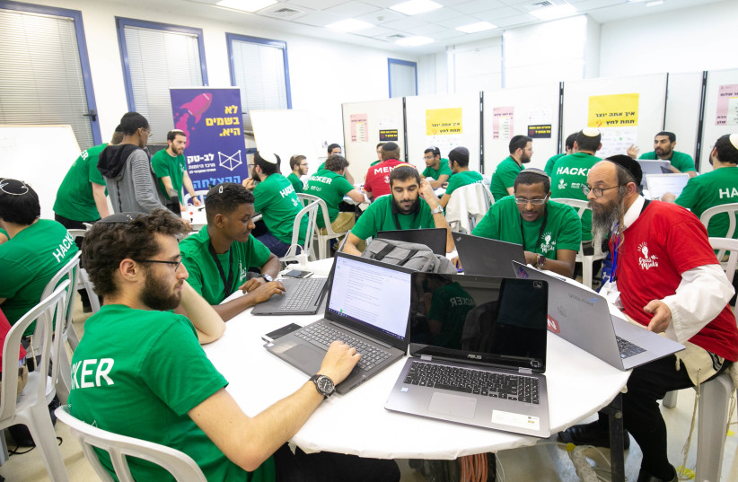 Jerusalem College of Technology students at work during the May 2019 hackathon (photo credit: MICHAEL ERENBURG)