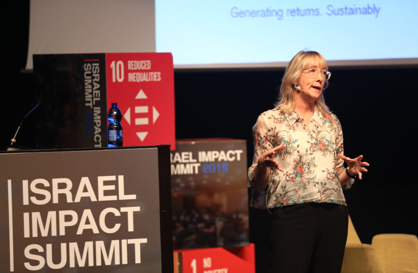 Marisa Drew, CEO Impact Advisory and Finance at Credit Suisse addresses the Israel Impact Summit, May 28, 2019 (photo credit: SHLOMI MIZRAHI)