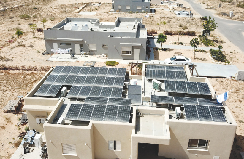 SOLAR PANELS on the roof of a house (photo credit: MORAG BITON)