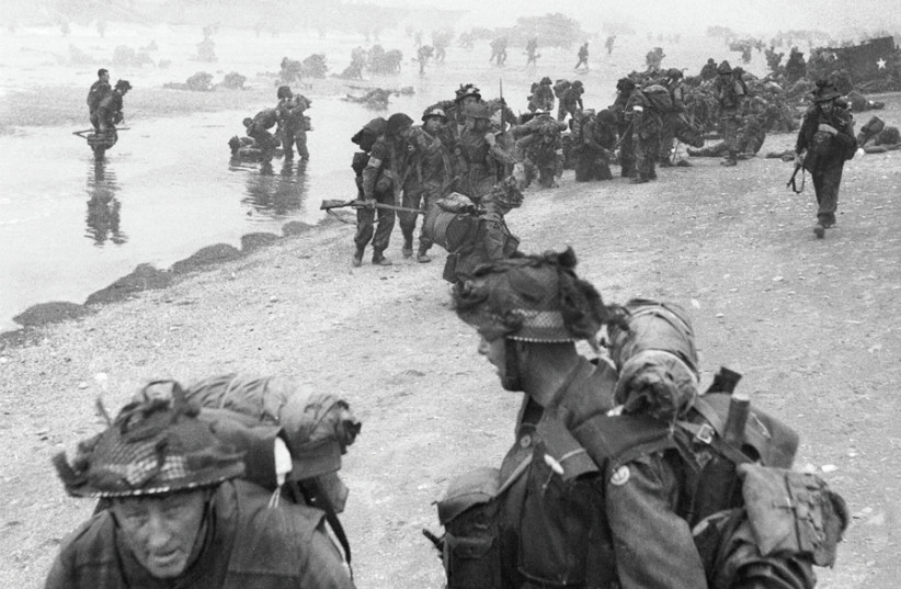 BRITISH FORCES during the D-Day invasion of Normandy on June 6, 1944: Troops of the 3rd Infantry Division on Queen Red Beach. (photo credit: Wikimedia Commons)