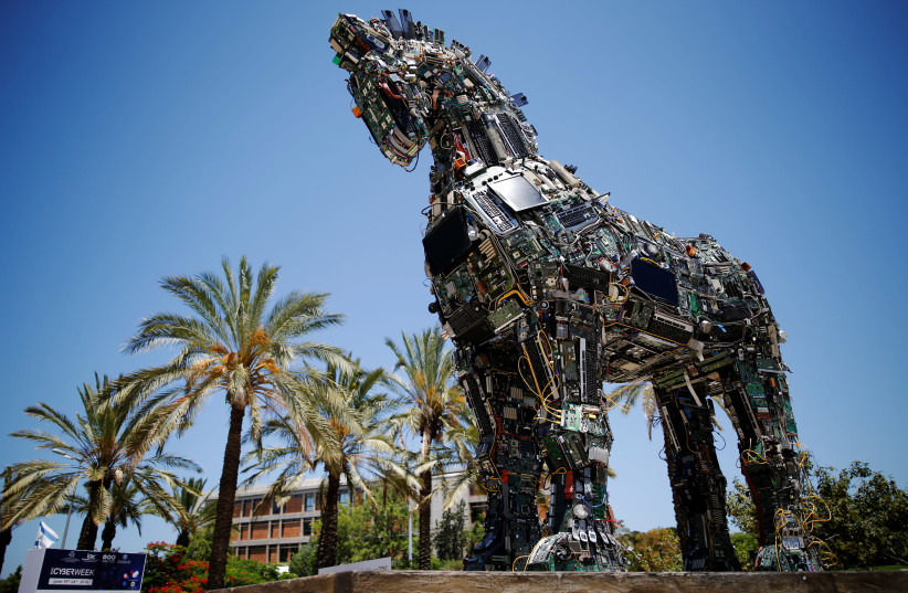 """A """"Cyber Horse"""", made from thousands of infected computer and cell phone bits, is displayed at the entrance to the annual Cyberweek conference at Tel Aviv University, Israel June 20, 2016. (photo credit: REUTERS/AMIR COHEN)"""