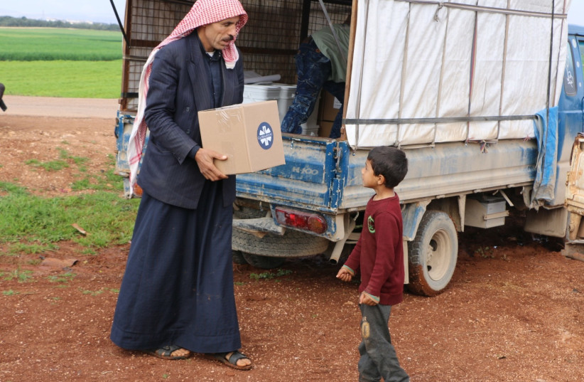 Syrian refugees in Aleppo receive aid with the help of Jewish students at Vassar College and Multifaith Alliance for Syrian Refugees (photo credit: MULTIFAITH ALLIANCE FOR SYRIAN REFUGEES (MFA))