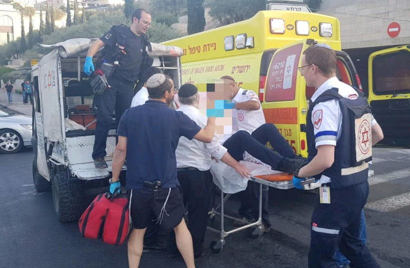 MDA paramedics evacuate a wounded man after he was stabbed in the Old City. (photo credit: MDA)