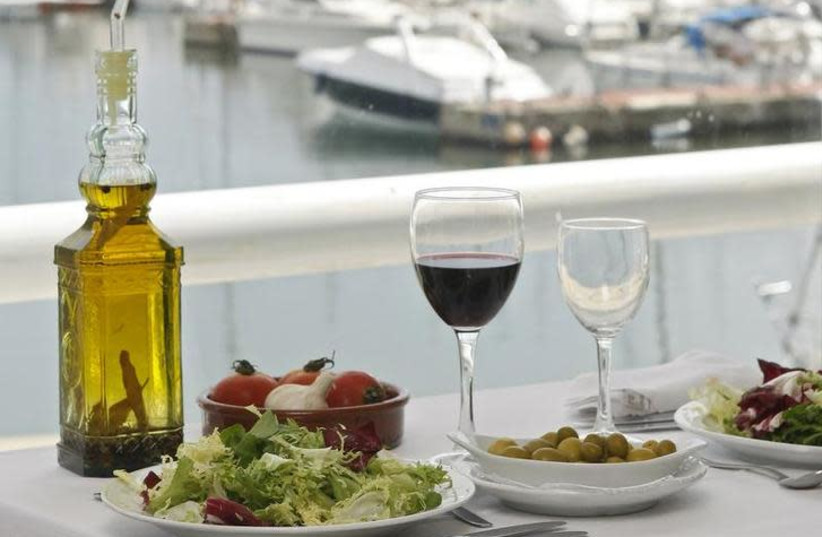 Mediterranean Food is seen on a table at a restaurant at the port of El Masnou, near Barcelona (photo credit: REUTERS)