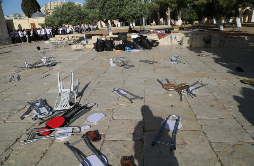 Chairs and objects thrown on the ground after Arabs rioted the decision to allow Jews to enter the Temple Mount on Jerusalem Day (photo credit: POLICE SPOKESPERSON'S UNIT)