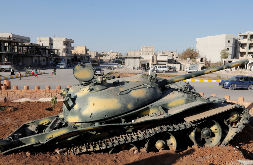 A Memorial in Kobani, Syria marks the site where an ISIS tank was destroyed in 2015. Bill Dean is remembered for his role as a US officer aiding the battle against ISIS (photo credit: REUTERS)