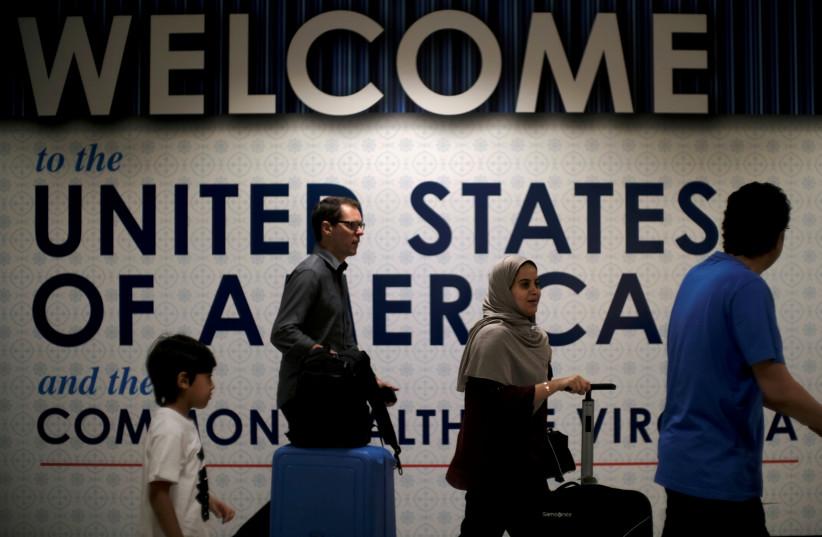 International passengers arrive at Washington Dulles International Airport (photo credit: REUTERS/JAMES LAWLER DUGGAN)