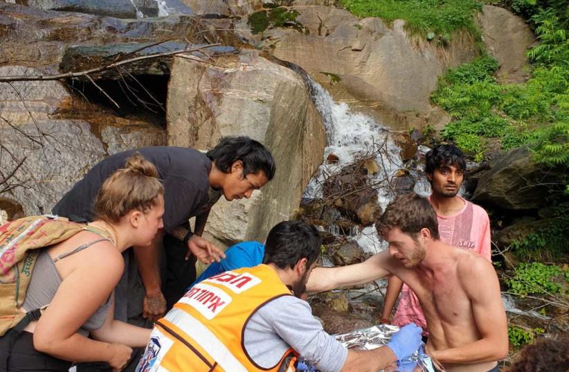 Chabad Rabbi Menachem Bakush assists wounded hiker in India (photo credit: Courtesy)