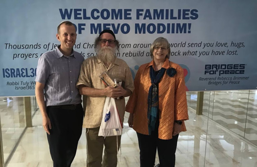 From left: Rabbi Tuly Weisz, moshav resident Shalom Shwartz and Bridges for Peace head Rebecca Brimmer (photo credit: ISRAEL365/BRIDGES FOR PEACE)