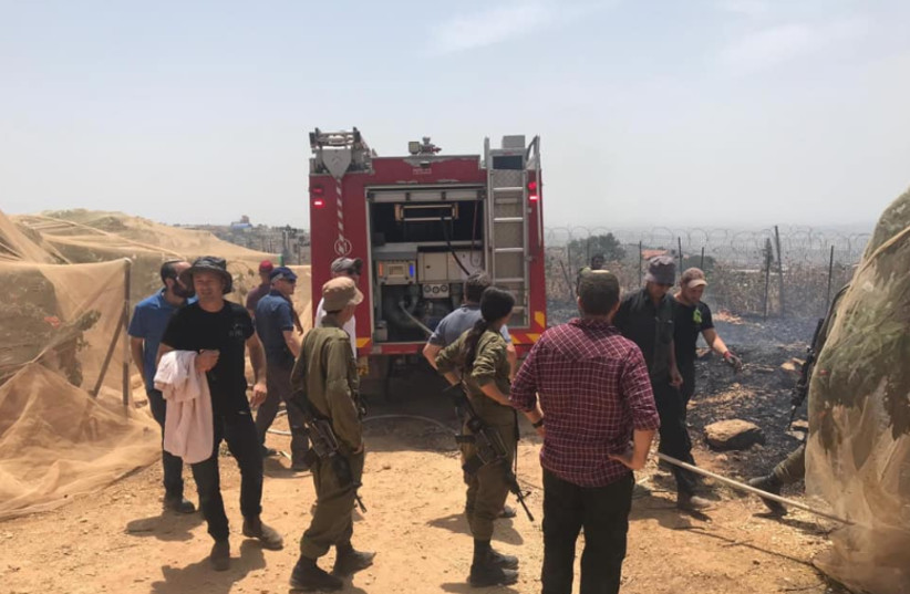 IDF and emergency fire personnel deal with a fire at cherry tree grove in the Etzion Bloc  (photo credit: YARON ROSENTHAL)