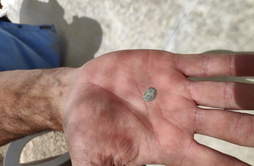 A Hasmonean era coin found at an archaeological excavation in Shiloh, June 2019 (photo credit: BINYAMIN SPOKESPERSON'S UNIT)