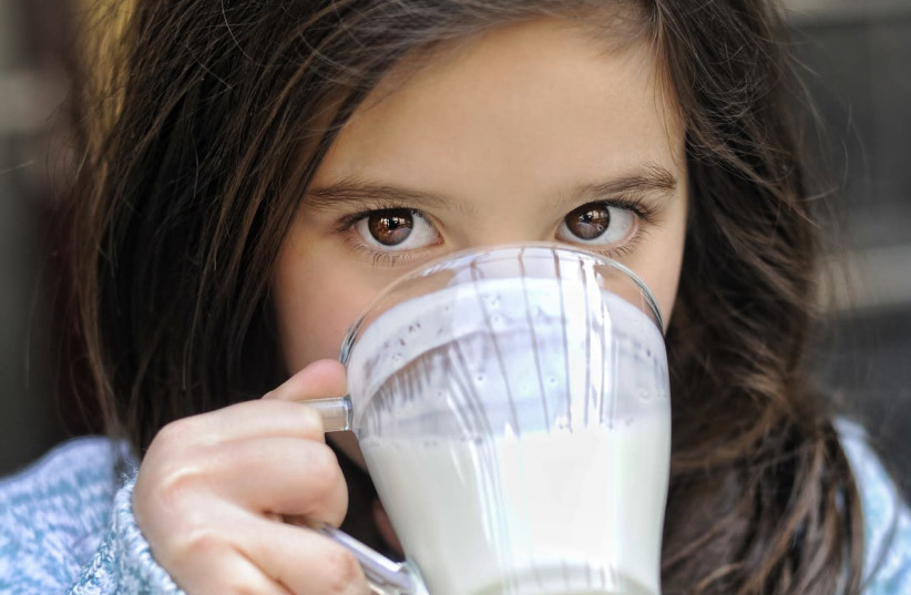 Girl drinking milk  (photo credit: Courtesy)