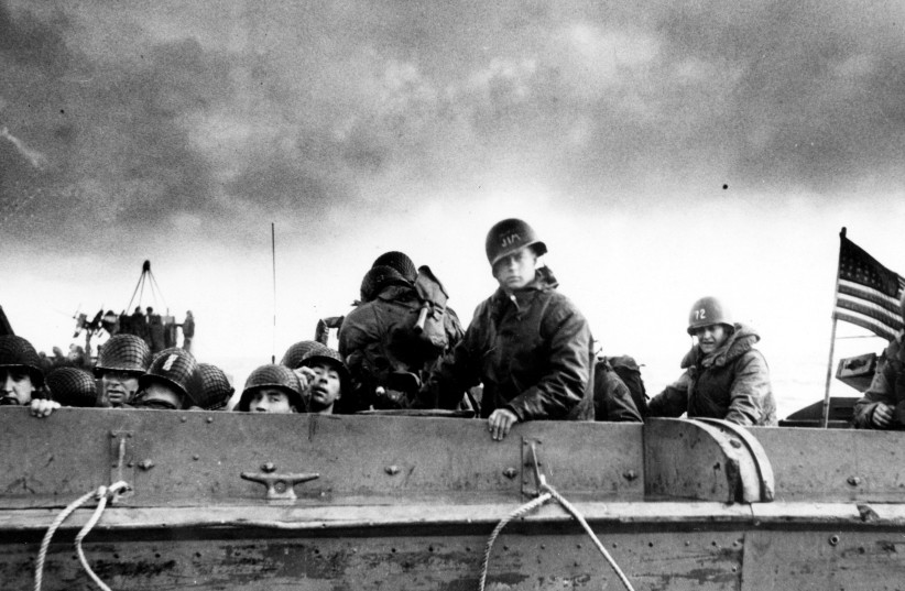 U.S. Army troops and crewmen aboard a Coast Guard manned LCVP approach a beach on D-Day in Normandy in 1944 (photo credit: REUTERS)