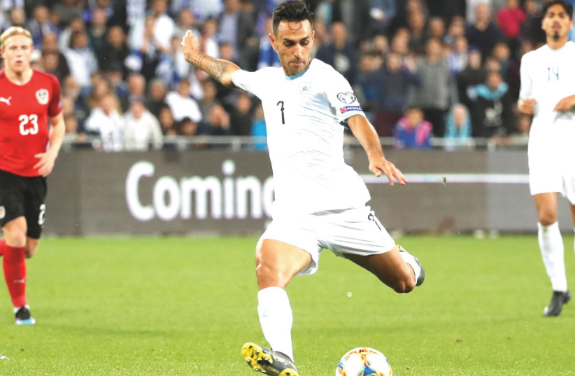 ERAN ZAHAVI will have to be in top form once again as Israel visits Latvia and Poland this weekend in Euro 2020 qualifying. In the blue-and-white's first two games, in March, Zahavi scored four total goals in a victory over Austria and a draw with Slovenia. (photo credit: REUTERS)